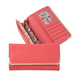 """Coral bi-fold wallet with a snap closure and gold tone hardware. Approximately 8"""" x 4"""" x 1"""""""