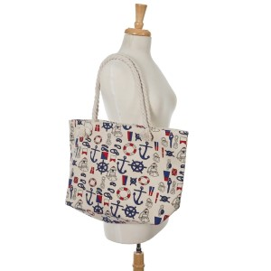 """Beige canvas tote bag with a top zipper and a nautical print. 45% polyester and 55% cotton. Measures 20"""" x 12"""" in size with a 10"""" handle drop."""