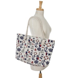 """Canvas tote bag with a top zipper and a nautical print. 45% polyester and 55% cotton. Measures 20"""" x 12"""" in size with a 10"""" handle drop."""