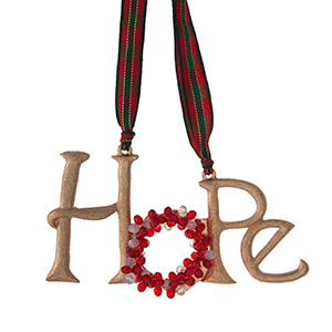 """Gold tone """"Hope"""" Christmas ornament with red and white beads. Approximately 4""""x 2."""""""