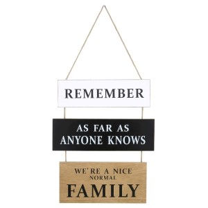 """""""Remember as far as anyone knows, we are a nice normal family"""" wall decor made of solid wood and a jute hanger. Measures approximately 21.5"""" x 11."""""""