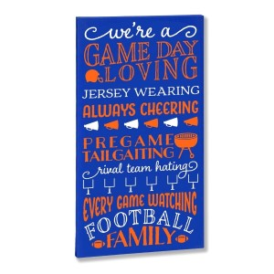 """The Game Day Loving"" canvas is perfect for any football fan. Each canvas comes in your favorite team colors and with a metal hook on the back for hanging. Measures approximately 10"" x 1.5"" x 19."""