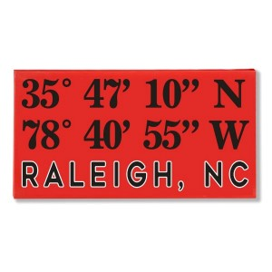"Canvas wall art with the coordinates of Raleigh, NC in your team colors to show your school pride. Canvas measures 10"" x 1.5"" x 19."""