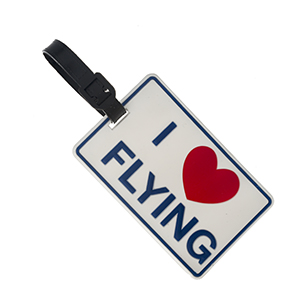 "Rubber luggage tag with name and address card, that says ""I love flying."""