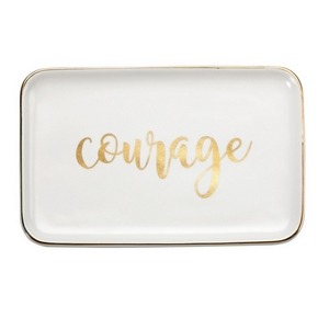 "White ceramic trinket tray featuring ""Courage"" and trimmed in gold. Measures approximately 6.5"" x 4"" in size."