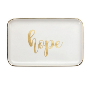 """White ceramic trinket tray featuring """"Hope"""" and trimmed in gold. Measures approximately 6.5"""" x 4"""" in size."""