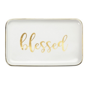 """White ceramic trinket tray featuring """"Blessed"""" and trimmed in gold. Measures approximately 6.5"""" x 4"""" in size."""
