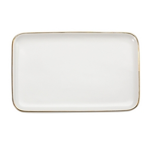 "White ceramic trinket tray trimmed in gold and perfect for adding your own monogram. Measures approximately 6.5"" x 4"" in size."