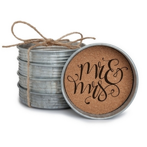 "Four piece mason jar lid coaster set featuring the ""Mr & Mrs"" painted on each. Approximately 4"" in diameter."