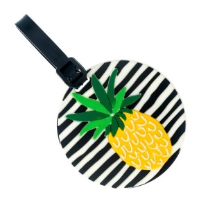 Black and white striped luggage tag with name and address card, and a pineapple.