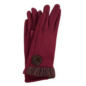 Solid, smart touch gloves with a ruffle trim and pom pom accent. One Size.