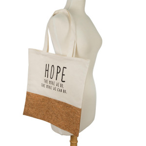 """Canvas and cork tote bag printed with """"Hope, the more we do, the more we can do"""" on the front. Measures 16"""" x 14"""" in size with an 8"""" handle drop."""