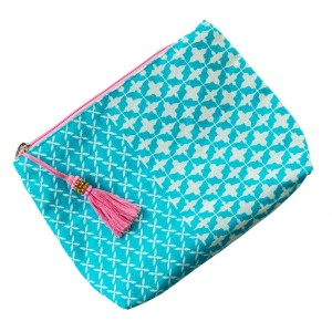 """Canvas bag with top zipper, tassel zipper pull and a lining along the inside. 100% cotton. Measures 9"""" x 7"""" in size."""