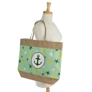 """Anchor and starfish printed tote bag with a fully lined interior, magnetic closure, and inside pocket. Measures 20"""" x 15"""" in size with a 10"""" shoulder drop. 55% cotton, 15% polyester, and 30% jute."""