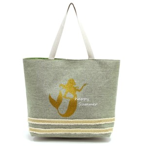 """Glitter mermaid printed tote bag with a fully lined interior, magnetic closure, and inside pocket. Measures 20"""" x 15"""" in size with a 10"""" shoulder drop. 55% cotton and 45% polyester."""