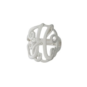"Silver tone stretch ring featuring the initial ""H""."