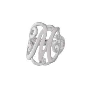 "Silver tone stretch ring featuring the initial ""M""."