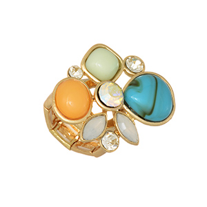 Gold tone stretch ring featuring a cluster of turquoise, mint green, peach, and ivory cabochons with rhinestone accents.