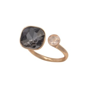 Gold tone adjustable ring with a clear and black diamond rhinestones.