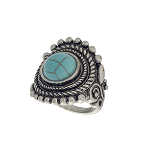 Burnished silver tone bohemian style ring with a turquoise stone focal. Size 7 only.