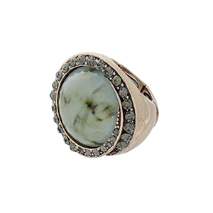 Burnished gold tone stretch ring with a green stone focal surrounded by black diamond rhinestones.