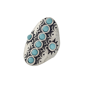 Burnished silver tone bohemian inspired stretch ring with turquoise bead accents.