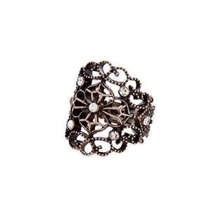 Burnished gold tone stretch ring with a filigree design and clear rhinestones.