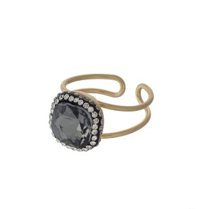 Gold tone adjustable ring with a black diamond stone.