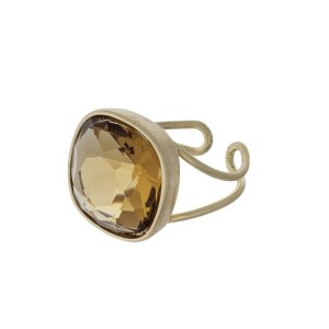 Gold tone adjustable ring with a topaz stone.