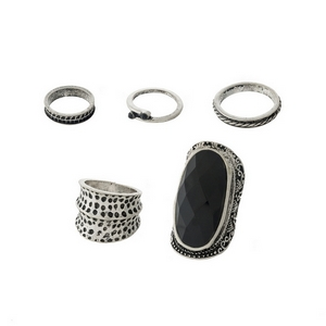 Burnished silver tone, one size ring set with a black faceted stone. Includes five rings.