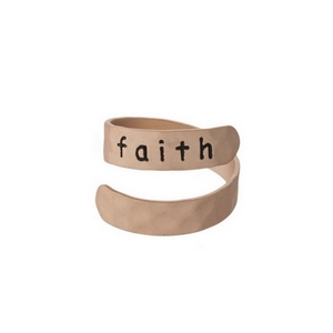 "Hammered copper tone, adjustable ring stamped with ""Faith."""