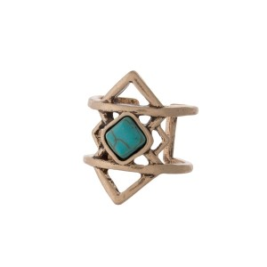 Burnished gold tone Aztec ring with a turquoise stone. One size - size 7.