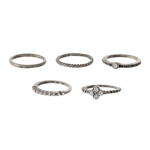 Burnished silver tone five piece ring set with mixed textures and clear rhinestones. One size - size 6.