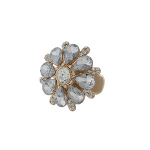 Gold tone stretch ring with a clear faceted stone flower.