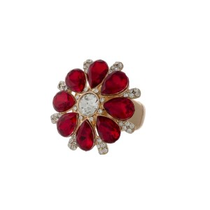 Gold tone stretch ring with a red faceted stone flower