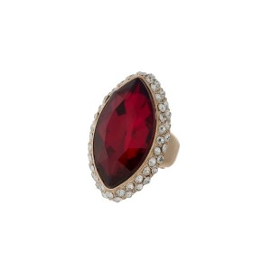 Gold tone stretch ring with a red oval faceted stone.