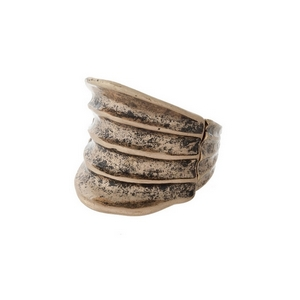 Burnished gold tone, stretch ring with a hammered texture.