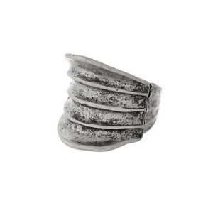 Burnished silver tone, stretch ring with a hammered texture.