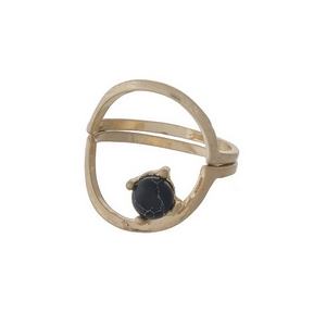 Dainty gold tone, two piece ring with a black stone. Approximately a size 7.
