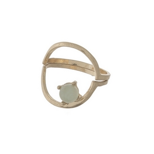 Dainty gold tone, two piece ring with a green stone. Approximately a size 7.