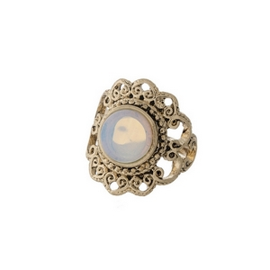 Gold tone scalloped ring with a white opal stone focal. One size - approximately a size 7.