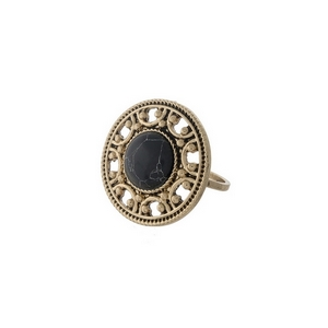 Gold tone ring with a black stone focal. One size - approximately a size 7.