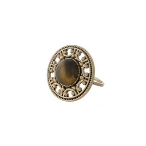 Gold tone ring with a brown stone focal. One size - approximately a size 7.