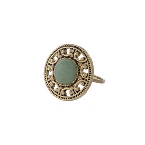 Gold tone ring with a green stone focal. One size - approximately a size 7.