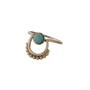 Dainty gold tone ring with a turquoise stone. Approximately a size 7.