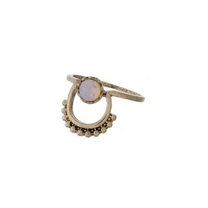 Dainty gold tone ring with an opal stone. Approximately a size 7.