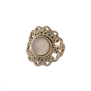 Gold tone ring with a gray stone flower focal. One size - approximately a size 7.