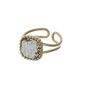 Gold tone adjustable ring with a clear glitter stone focal.