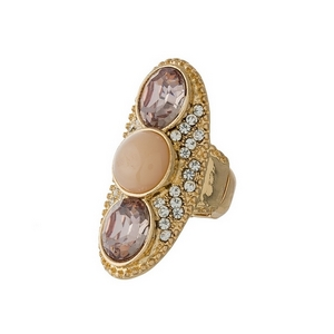 Gold tone stretch ring featuring peach and blush pink stones.