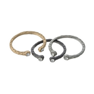 Three piece adjustable ring set in silver, gold and hematite tones.